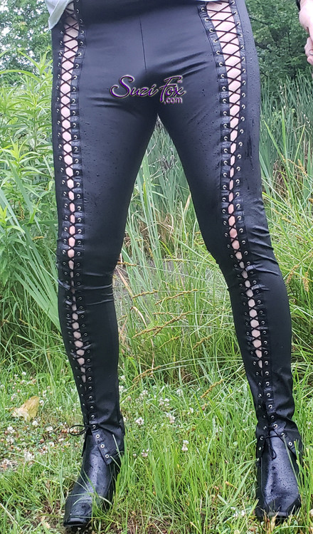 Mens Hiphugger Leggings with OPTIONAL Grommet Lacing, shown in Matte Black (no shine) Vinyl/PVC Spandex, custom made by Suzi Fox. Photo by one of our sexy customers, walking in the park in the rain! • Choose any fabric on this site, including vinyl/PVC, metallic foil, metallic mystique, wetlook lycra Spandex, Milliskin Tricot Spandex. The vinyl/PVC is a latex alternative, great for people allergic to latex! • Custom sizing available. • Plus size available. • 1 inch elastic at the waist. • Optional rear patch pockets. • Optional belt loops. • Optional ankle zippers. • Optional Faux zipper pockets. • Worldwide shipping. • Made in the U.S.A.