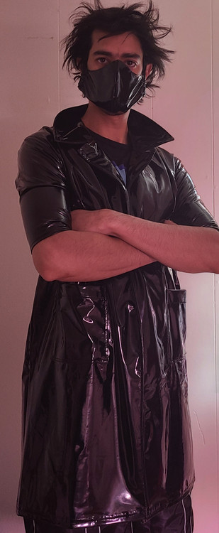 Customer photo!  Mens Custom Lab Coat  in Gloss Black Vinyl/PVC Spandex, custom made by Suzi Fox. Custom made to your measurements! • Choose any fabric on this site, including vinyl/PVC, metallic foil, metallic mystique, wetlook lycra Spandex, Milliskin Tricot Spandex. The vinyl/PVC is a latex alternative, great for people allergic to latex! • Open front (no closure) • Plus size available. • Optional wrist zippers. • Worldwide shipping. • Made in the U.S.A.