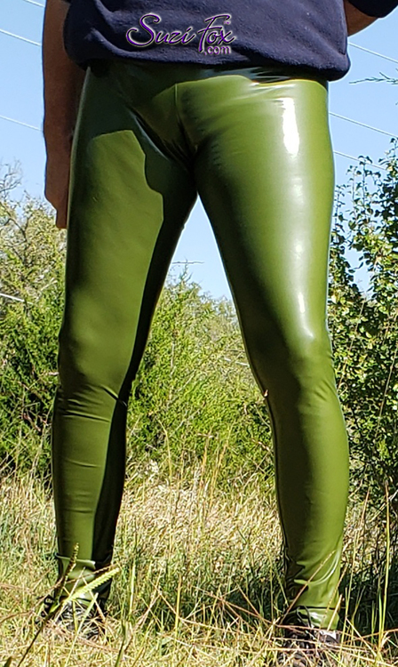 Mens Hiphugger Leggings shown in Gloss Army Green Vinyl/PVC Spandex, custom made by Suzi Fox. • Choose any fabric on this site, including vinyl/PVC coated Spandex, metallic foil, metallic mystique, wetlook lycra Spandex, Milliskin Tricot Spandex. The vinyl/PVC is a latex alternative, great for people allergic to latex! • Custom sizing available. • Plus size available. • 1 inch elastic at the waist. • Optional rear patch pockets. • Optional belt loops. • Optional ankle zippers. • Optional 1, 2 or 3-slider crotch zipper. • Optional scrunch butt (gathered rear). • Worldwide shipping. • Made in the U.S.A.