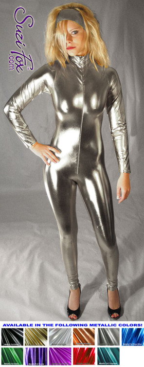 "Custom Catsuit by Suzi Fox shown in Gunmetal metallic foil coated Nylon Spandex.  You can order this Catsuit in almost any fabric on this site.  • Available in gold, silver, copper, royal blue, purple, turquoise, red, green, fuchsia, gun metal, black faux leather/rubber Metallic foil coated spandex. • Your choice of front or back zipper (front zipper shown). • Optional 1 or 2-slider crotch zipper, and ""Selene"" from Underworld TS Brass zipper, or aluminum circular slider zipper like Catwoman comic characters. • Optional wrist zippers • Optional ankle zippers • Optional finger loops • Optional rear patch pockets • Made in the U.S.A."