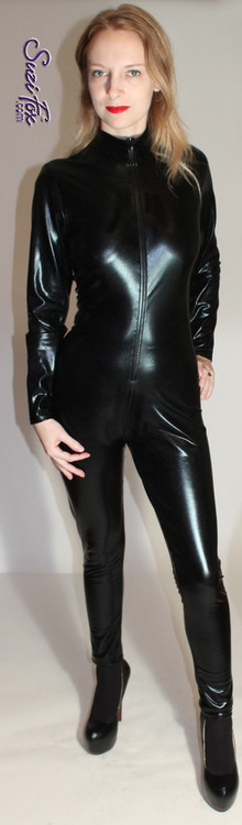 """Womens Custom Catsuit shown in Black Faux Leather/Rubber metallic foil coated spandex, custom made by Suzi Fox.  You can order this Catsuit in almost any fabric on this site.  • Available in gold, silver, copper, royal blue, purple, turquoise, red, green, fuchsia, gun metal, black faux leather/rubber Metallic foil coated spandex. • Your choice of front or back zipper (front zipper shown). • Optional 1 or 2-slider crotch zipper, and """"Selene"""" from Underworld TS Brass zipper, or aluminum circular slider zipper like Catwoman comic characters. • Optional wrist zippers • Optional ankle zippers • Optional finger loops • Optional rear patch pockets • Made in the U.S.A. • Plus sizes available"""