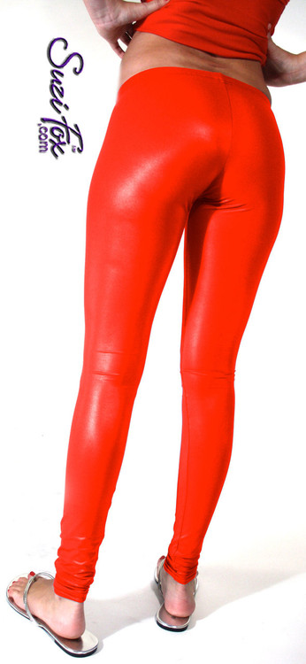 Womens Leggings shown in Red Wet Look Lycra Spandex, custom made by Suzi Fox. Shown in hiphugger rise. You can order this in almost any fabric on this site.  • Custom made to your measurements! • 1 inch elastic at the waist. • Optional 1 or 2-slider crotch zipper. • Optional ankle zippers • Optional rear patch pockets • Optional belt loops • Made in the U.S.A.