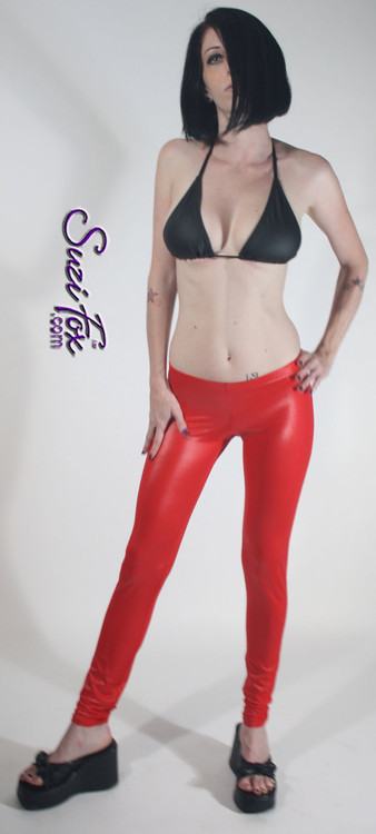 Womens Leggings shown in Red Wet Look Lycra Spandex, custom made by Suzi Fox. Shown in Super Low rise. You can order this in almost any fabric on this site.  • Custom made to your measurements! • 1 inch elastic at the waist. • Optional 1 or 2-slider crotch zipper. • Optional ankle zippers • Optional rear patch pockets • Optional belt loops • Made in the U.S.A.