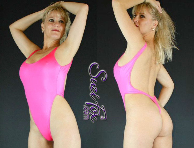 Womens One Piece T-back Thong Swim Suit shown in Neon Pink Milliskin Tricot Spandex, custom made by Suzi Fox. • Custom made to your measurements. • The high leg hole, low back and t-back thong rear create a stunning and sexy suit. • Available in any fabric on this site. • Made in the U.S.A.