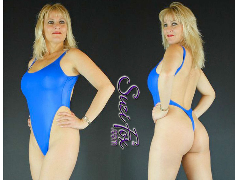 Womens One Piece T-back Thong Swim Suit shown in Royal Blue Milliskin Tricot Spandex custom made by Suzi Fox. • Custom made to your measurements. • The high leg hole, low back and t-back thong rear create a stunning and sexy suit. • Available in any fabric on this site. • Made in the U.S.A.