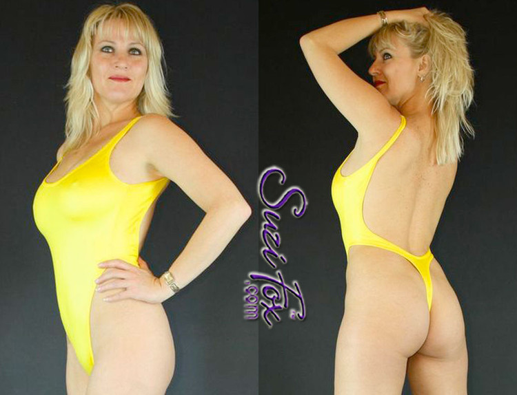 Womens One Piece, T-Back Thong Swimsuit, shown in Yellow Milliskin Tricot Spandex, custom made by Suzi Fox. • Custom made to your measurements. • The high leg hole, low back and t-back thong rear create a stunning and sexy suit. • Available in any fabric on this site. • Made in the U.S.A.