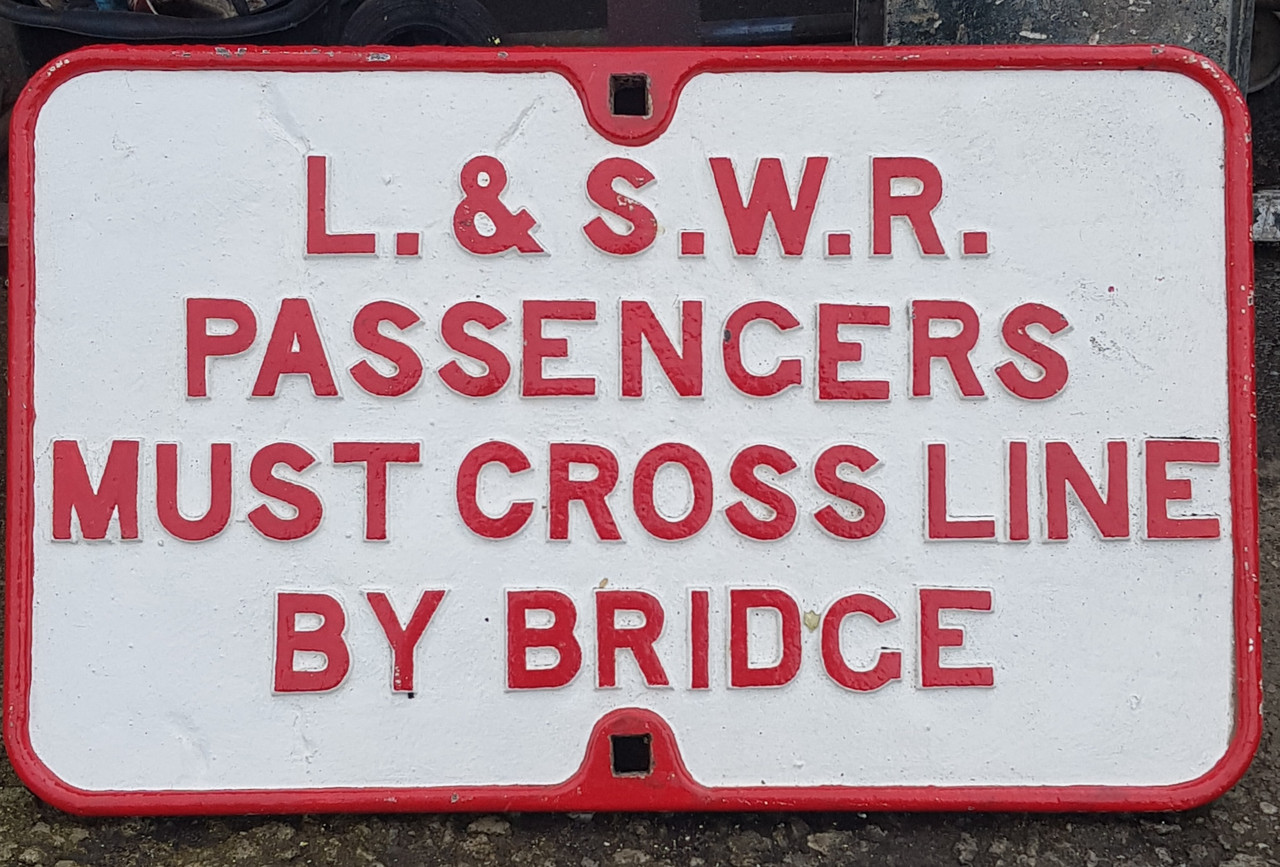 VT 3658. CAST IRON L.& S.W.RLY PASSENGERS CROSS THE LINE SIGN.