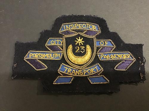 GD 499 CITY OF PORTSMOUTH PASSENGER TRANSPORT INSPECTOR CAP BADGE.