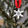 Custom Hand stamped fine pewter snowflake ornament, personalized with your message, shown on Christmas tree