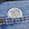 Fine pewter hand stamped pocket charm in a pocket