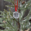 Custom fine pewter memorial Christmas ornament, personalized with your child's footprints or handprints, shown on a Christmas tree