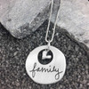 """Optional handmade sterling silver heart hung with custom silver Sculpted Circle Cut Out Handwriting Necklace, personalized with handwritten word """"Family"""""""