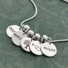 Sterling silver Family Tree Charm, shown on silver name disc necklace