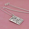 """Side view of silver custom best friends necklace, with """"Friends are Like Stars"""" hand stamped on the front"""