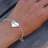 Hand Stamped Sterling Silver Mom Bracelet shown on a model