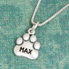 Large Sterling Paw Charm with name Max stamped on it, shown on sterling silver chain