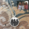 Custom sterling silver circle necklace engraved with silhouette of 3 women, shown with original photo used to personalize it