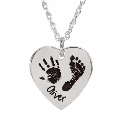 Actual child's handprint and footprint engraved on a silver heart charm on a personalized silver necklace
