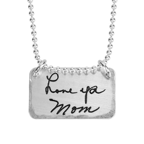 Sterling silver rectangle jewelry engraved with handwritten note & signature from Mom, shown on white