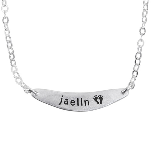 Custom fine silver arc charm, personalized with child's name stamped on the arc, shown close up on white