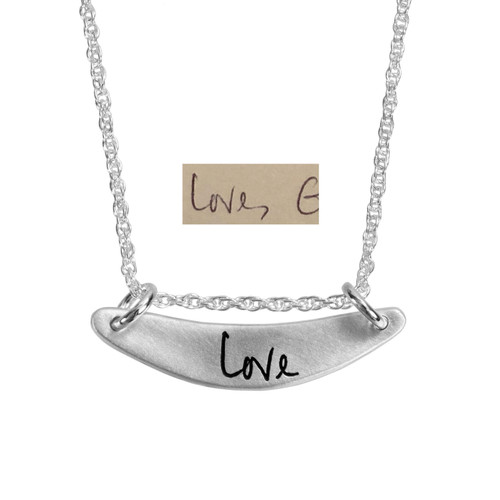 Custom silver arc personalized handwriting necklace, engraved with the word Love, shown with the actual handwriting used to create it
