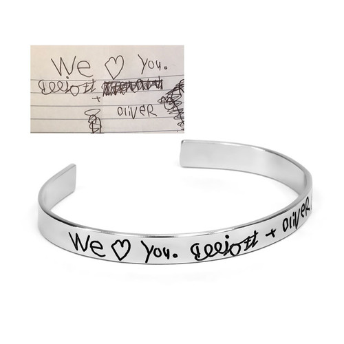 Handwritten note engraved onto a cuff bracelet, showing the original kids' handwriting used to personalize it