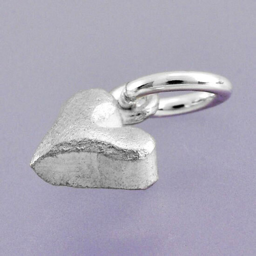 fine silver Sideways Sculpted Heart Charm, shown from the side