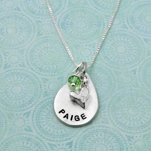 Handmade fine silver teardrop stamped with child's name, shown with our tapered Swarovski Birthstone