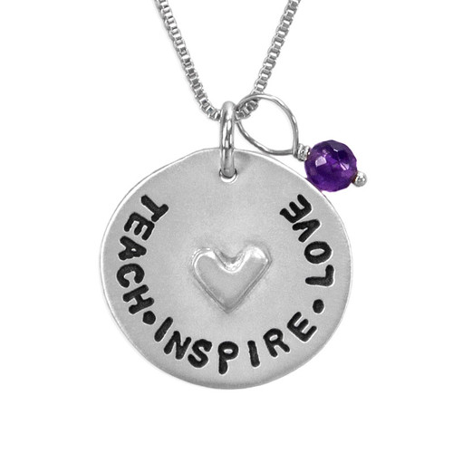 """Fine silver Teacher gift necklace, with hand stamped  message, """"Teach Inspire Love"""", with amethyst stone, shown close up on white"""