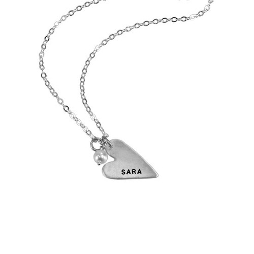 handmade long silver heart charm, hand stamped with a name, hung with a pearl , on a silver chain, shown on a white background
