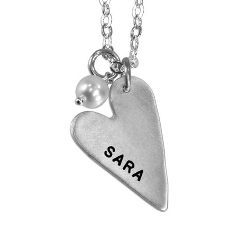handmade long silver heart charm, hand stamped with a name, hung with a pearl , on a silver chain, shown on a white background, close up