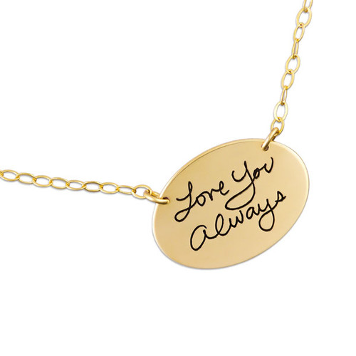 Custom gold oval handwriting necklace, personalized with loved one's actual handwriting, shown close up on white