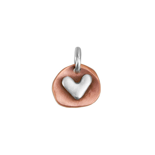 handmade copper and silver heart charm, with optional hand stamping on back, shown close up on white