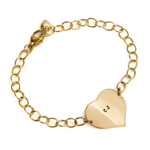 """Hand Stamped Gold Heart Linked Bracelet, shown from the side on white, with """"CJ"""" stamped on the heart"""