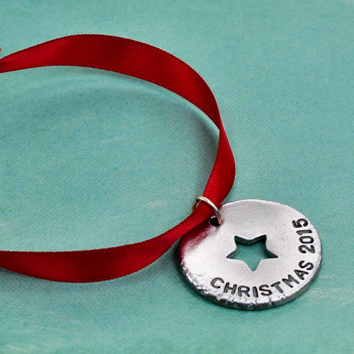 Personalized ornament with Christmas 2015 hand stamped on it
