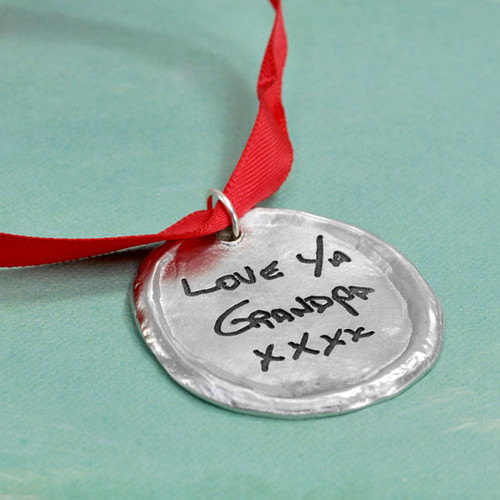 Custom fine pewter Christmas ornament, personalized with your handwriting, shown on green