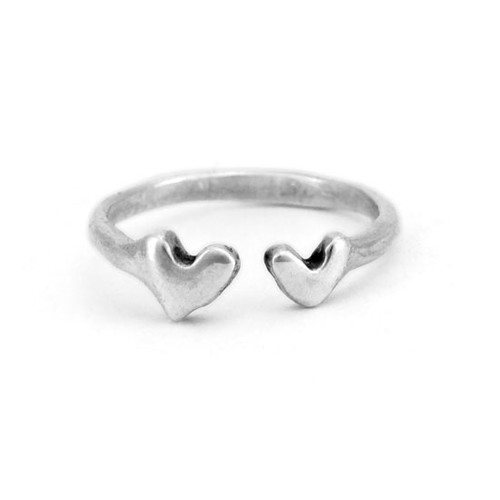 Hand crafted silver ring with two hearts, shown on white