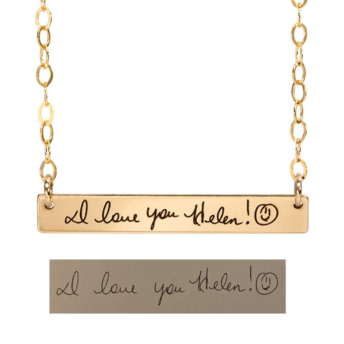 Gold bar necklace with handwritten note from sister, shown with the original handwriting used to personalize it