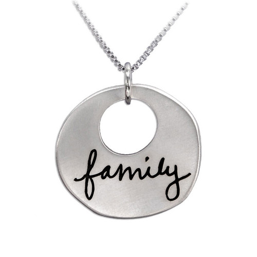 """Custom silver Sculpted Circle Cut Out Handwriting Necklace, personalized with handwritten word """"Family"""", shown close up on white"""