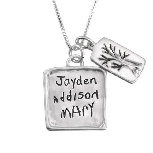 Personalized silver square charm engraved with handwritten kids names, and hung with custom treen silver charm on a silver chain.