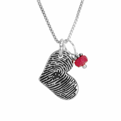 Silver fingerprint heart necklace with birthstone, shown close up on white