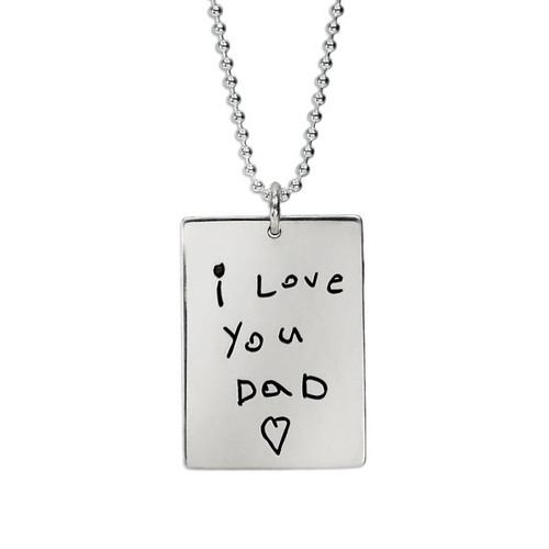 Custom silver necklace personalized with kid's handwritten note on rectangle tag for man or woman, shown close up on white