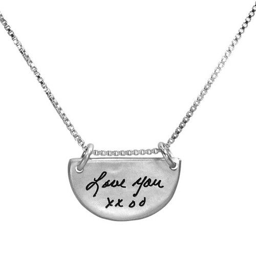 Actual handwriting on custom silver half circle necklace, shown on white