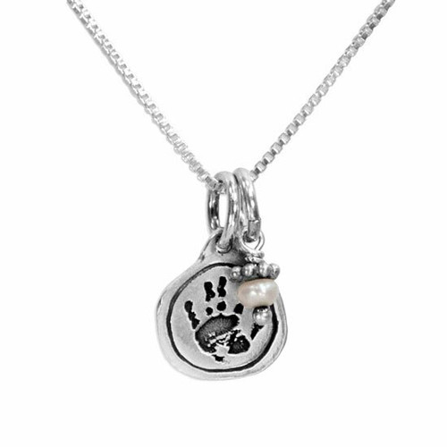 Custom sterling silver circle charm personalized with child's actual handprint,  hung with child's birthstone, on a silver chain, shown close up on white