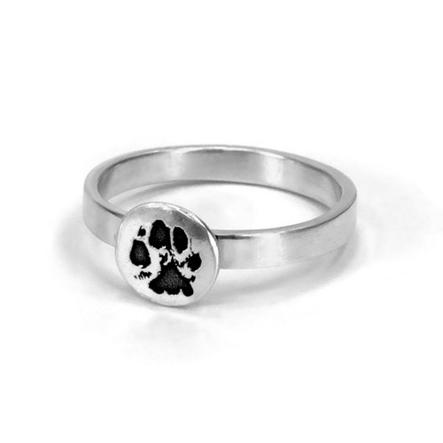 Custom silver paw print jewelry ring, personalized with your pet's actual pawprint, shown close up on white