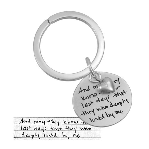 Custom handwriting sterling silver key chain, shown with original handwritten note used to personalize it, shown close up on white