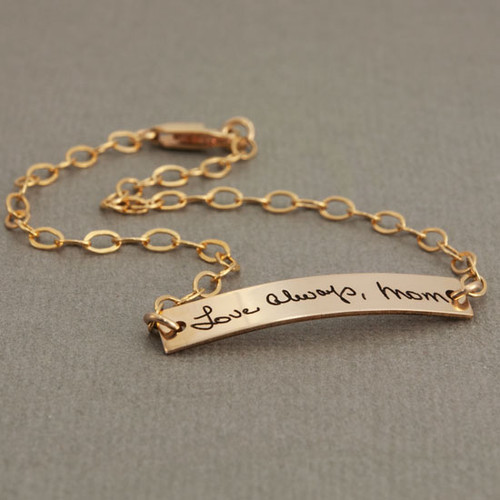Dainty bracelet with your actual writing in gold, shown from the side