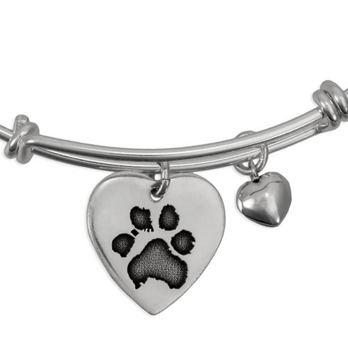 Close up of custom expandable bracelet , personalized with your pet's actual paw print engraved on a silver heart charm, with a silver puffed heart