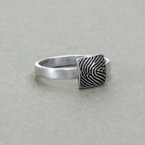 custom square shaped fingerprint jewelry ring in sterling silver, shown on model