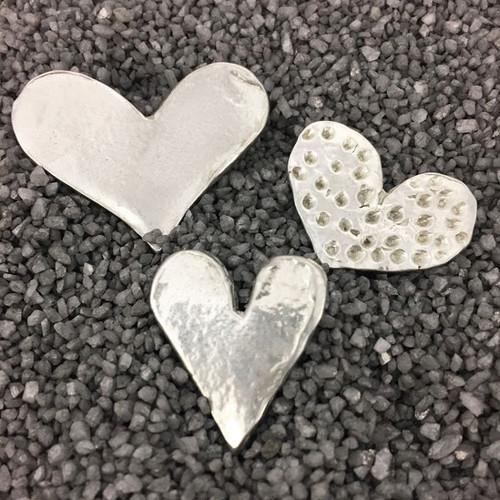 Handmade pewter magnets